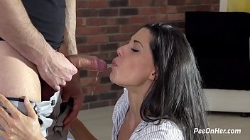 Alexa Tomas kneel in front of her man as he unleashes a long stream of piss