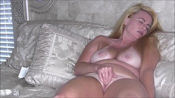 Blonde MILF Masturbating On The Bed