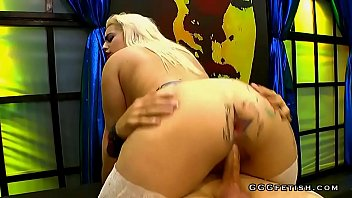 Tattooed slut with piercings enjoys gangbang orgies
