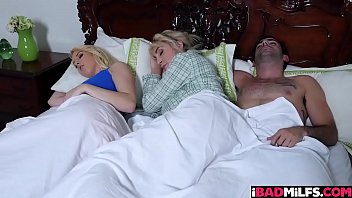 Darcie Belle and her boyfriend Jake Adams were cuddling in bed until milf Maxim Law came a knocking and joins them!
