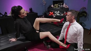 Dark haired mistress Cherry Torn makes pervert guy sniffing her shoes and feet in black stockings then she anal fucks him in bondage