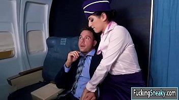 Sexy flight attendant fucks a passenger