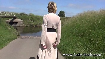 Sexy Granny Flashing Her Tits And Playing With Her Pussy By The River thumbnail