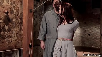 Hot gagged brunette slave Mandy Muse in standing crotch rope bondage gets stripped of by master Sgt Major and then fucked with dick on a stick