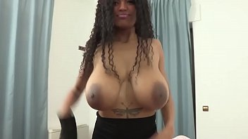 Busty Brazilian plays with her boobs for the camera. She loves being watched!