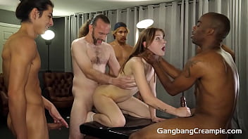 Redhead Spinner Sucking Cocks Behind The Scenes and Creampied In Gangbang