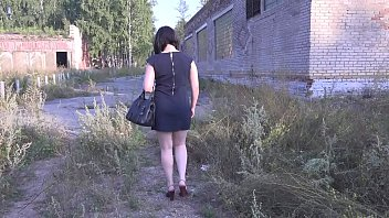 A girl with a beautiful butt in a public dressing room tries on things, and then walks without the pant outside and picks up a dress.