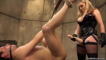 Huge tits blonde MILF clinic owner Aiden Starr straps male patient Marcelo and whips him then in bondage pegs him with thick strapon cock