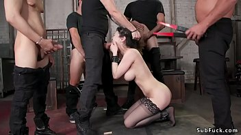 Watch Big tits clamped brunette slut Audrey Noir in black stockings kneeling and sucking big cock then getting gangbang and double penetration preview