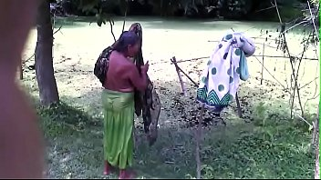 Bath of old woman in pond side HIGH
