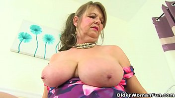 English granny Elle unzips her summer dress and gives her old fanny the attention it needs. Bonus video: British gilf Zadi.