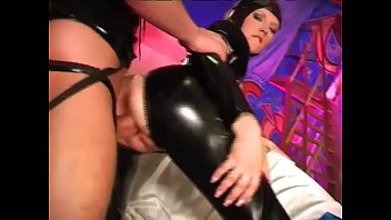 A sexy slave in latex is tied up and fucked