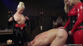 Two hot MILF femdoms Maitresse Madeline Marlowe and Lorelei Lee in latex torment chained muscled man slave Tanner Tatum then anal fuck him with strap on dicks