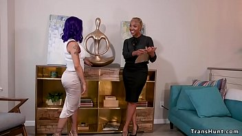 Watch Purple haired busty shemale TS Foxxy seduces big booty tall ebony real estate agent Lotus Lain and then fucks her deep throat and pussy in bed preview
