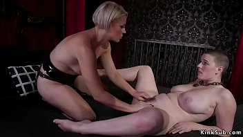 Blonde Milf mistress Helena Locke makes natural busty slave Riley Nixon with trimmed head to eat her pierced pussy then anal fucks her and canes in dungeon