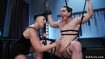Big tits brunette Mistress Kara electro shocks big cock male then anal toys him till fucks his mouth with huge strap on cock and rides dildo gag