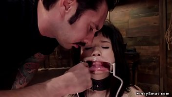 Wide spreaded mouth brunette slave gets mouth banged and pussy whipped