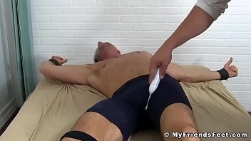 Foot tickling with restrained hunky dude