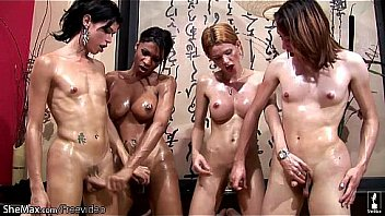 Four shemales enjoy oil massage and anal sex orgy