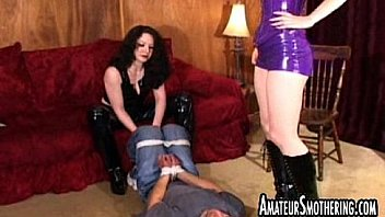 Bitches in full latex smothering and facesitting a man 02