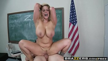 Blonde milf gagging on dick in a classroom