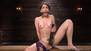 Natural tits blonde gagged beauty Kristen Scott masturbates with Magic Wand and has intense orgasm then tied in bench machine fucked in dungeon