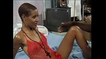 Skinny ebony bitch gives a blowjob to a muscular black guy and gets a cum on face