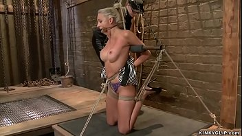 Hot big tits blonde slave Katie Summers is bound on knees and tormented and whipped by mistress Claire Adams then gets spanked and vibrated on hogtie
