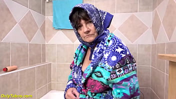 our ugly big saggy tits 73 years old grandma toying her wet hairy bush with a massive dildo and peeing at the bathtube