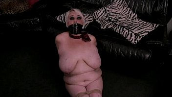 Bound naked and tape gagged