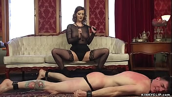 Hot busty brunette MILF femdom Cherry Torn in sexy lingerie dominates bound man Artemis Faux with cock in chastity then pegs him and fucks his mouth