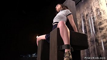 Brunette slave Juliette March bound in massive wooden seat and pussy vibed