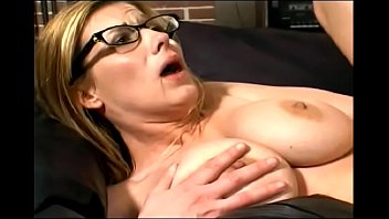 Woman MILF in glasses loves being fucked by a strong young guy