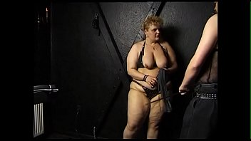Fat wife ties man to the cross, fetish sex