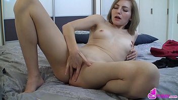 Kinky blonde with short hair shows her shaved pussy and plays with it, fingering it deep while in black stockings.