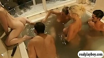 Group of singles having fun in the bathtub and in bed