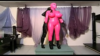 Two perverse and masked lesbians play with a pillory