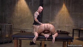 Big boobs blonde Milf London River with ball gag tied up squats and gets submission from muscular master Thumbnail