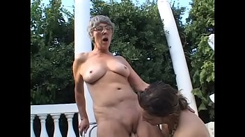 Slutty granny Margo loves sucking on a old cock outdoors then fuck with young guy Thumbnail