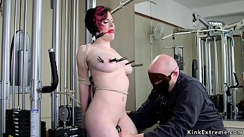 Watch Masked master Sgt_Major tied up natural busty redhead babe Iona Grace at the gym and clamps her tits and vibrates her pussy_then hogties her on the bench preview