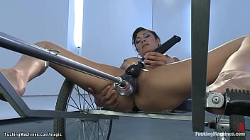 Oiled big boobs little brunette babe Beretta James laying in carriole and fucking machine and squirting then getting double penetration machine to orgasm