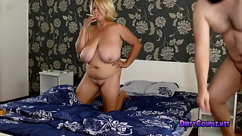 Huge boobs Ludmila lights a cigarette and play with her boobs to excite her mature fucker