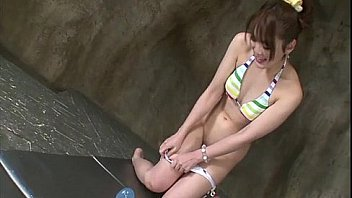 Squirting idol Tomoka Sakurai in a colorful bikini toys her lovebox making her g