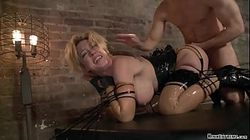 Hot big boobs blonde MILF slave Dee Williams in latex lingerie is hard whipped by gimp Bill Bailey then anal fucked in bondage balls deep from behind