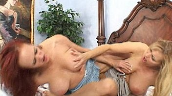 Sexy redhead & a brunette with big tits in lesbian action on the bed