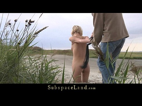 Leashed slave walked as pet on the beach