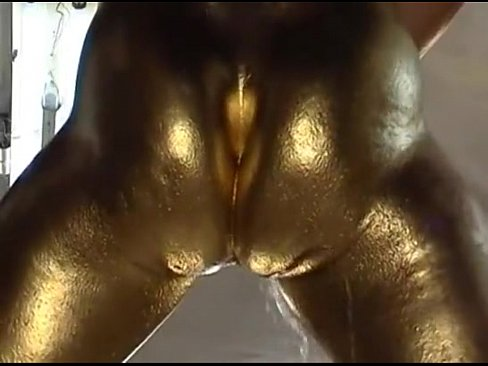 Gold painted pussy fucks with metal dildo