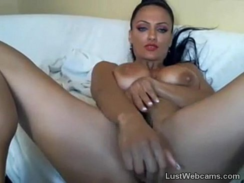 Big titted brunette toys her pussy on cam
