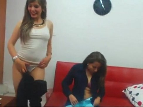 Four horny camgirls stripping slowly on Live69Girls.Com