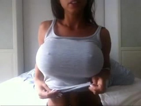 Hot babe with an amazing pair of boobs showing of